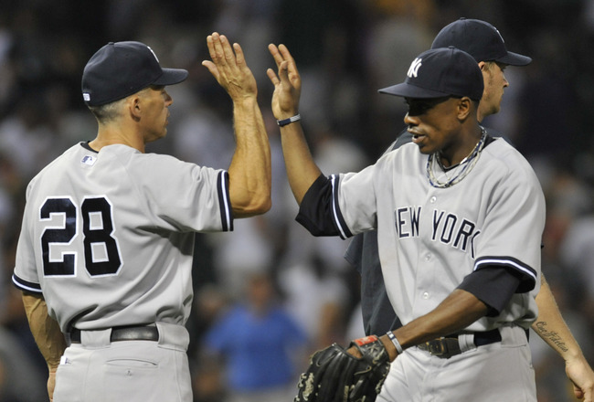 CHICAGO, IL - AUGUST 01: Joe Girardi #28 manager of the New York Yankees and Curtis Granderson #14 celebrate the Yankees 3-2 victory against the Chicago White Sox on August 1, 2011 at U.S. Cellular Field in Chicago, Illinois.  (Photo by David Banks/Getty