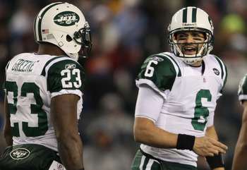 FOXBORO, MA - JANUARY 16:  Mark Sanchez #6 and Shonn Greene #23 of the New York Jets reacts to a play against the New England Patriots during their 2011 AFC divisional playoff game at Gillette Stadium on January 16, 2011 in Foxboro, Massachusetts.  (Photo