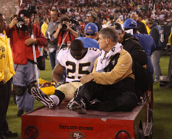 SAN FRANCISCO - SEPTEMBER 20:  Reggie Bush #25 of the New Orleans Saints leaves the field after being injured during their game against the San Francisco 49ers at Candlestick Park on September 20, 2010 in San Francisco, California.  (Photo by Ezra Shaw/Ge