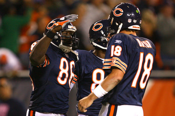 CHICAGO - SEPTEMBER 28:  (L-R) Marty Booker #86, Brandon Lloyd #80 and Kyle Orton #18 of the Chicago Bears celebrate after Orton threw a 23-yard touchdown pass to Booker in the second quarter against  the Philadelphia Eagles at Soldier Field on September