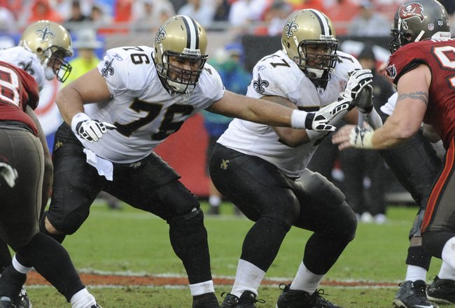 TAMPA, FL - NOVEMBER 30: Center Jonathan Goodwin #76 and guard Carl Nicks #77 of the New Orleans Saints set to block against the Tampa Bay Buccaneers at Raymond James Stadium on November 30, 2008 in Tampa, Florida.  (Photo by Al Messerschmidt/Getty Images
