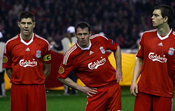 LIVERPOOL, ENGLAND - FEBRUARY 18:  Steven Gerrard,Jamie Carragher and Daniel Agger in the pre match team line up during the UEFA Europa League Round 32 first leg match between Liverpool and Unirea Urzicen at Anfield on February 18, 2010 in Liverpool, Engl