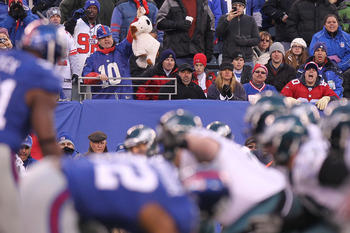 EAST RUTHERFORD, NJ - DECEMBER 19:  A fan of the New York Giants holds up a stuffed dog in a noose during the game against the Philadelphia Eagles at New Meadowlands Stadium on December 19, 2010 in East Rutherford, New Jersey.  (Photo by Nick Laham/Getty