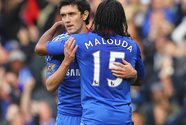 LONDON, ENGLAND - OCTOBER 23: Yury Zhirkov of Chelsea congratulates the opening scorer Florent Malouda during the Barclays Premier League match between Chelsea and Wolverhampton Wanderers at Stamford Bridge on October 23, 2010 in London, England.  (Photo