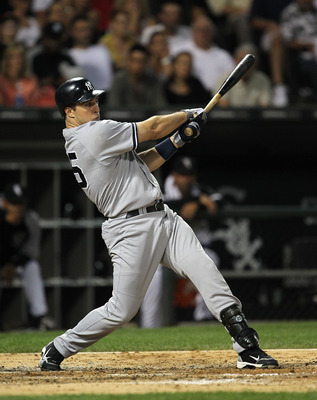 CHICAGO, IL - AUGUST 02:  Mark Teixeira #25 of the New York Yankees gets a hit against the Chicago White Sox at U.S. Cellular Field on August 2, 2011 in Chicago, Illinois.  (Photo by Jonathan Daniel/Getty Images)