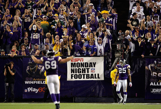 MINNEAPOLIS - OCTOBER 05:  The crowd cheers as defensive end Jared Allen #69 of the Minnesota Vikings celebrates after a sack during the Monday Night Football game against the Green Bay Packers on October 5, 2009 at Hubert H. Humphrey Metrodome in Minneap