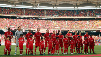 KUALA LUMPUR, MALAYSIA - JULY 16: Liverpool lines up during the pre-match ceremony during the pre-season friendly match between Malaysia and Liverpool at the Bukit Jalil National Stadium on July 16, 2011 in Kuala Lumpur, Malaysia. (Photo by Stanley Chou/G