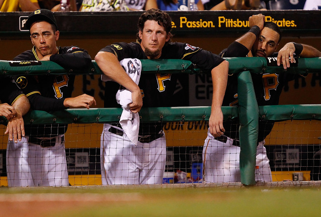 PITTSBURGH - AUGUST 02:  Jeff Karstens #27, Joel Hanrahan #52, and Pedro Alvarez #24 of the Pittsburgh Pirates watch the final out of the game against the Chicago Cubs during the game on August 2, 2011 at PNC Park in Pittsburgh, Pennsylvania.  (Photo by J