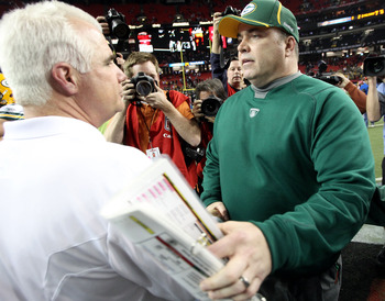 ATLANTA, GA - JANUARY 15:  Head coach Mike Smith of the Atlanta Falcons congratulates head coach Mike McCarthy of the Green Bay Packers after the Packers won 48-21 during their 2011 NFC divisional playoff game at Georgia Dome on January 15, 2011 in Atlant