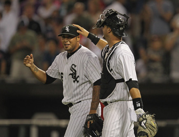 CHICAGO, IL - JULY 29: Sergio Santos #46 of the Chicago White Sox gets a pat on the head from teammate A.J. Pierzynski #12 after a win over the Boston Red Sox at U.S. Cellular Field on July 29, 2011 in Chicago, Illinois. The White Sox defeated the Red Sox