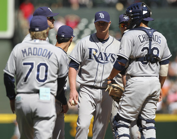 SEATTLE - JULY 30:  Starting pitcher Alex Cobb #53 of the Tampa Bay Rays is removed from the game by manager Joe Maddon #70 against the Seattle Mariners at Safeco Field on July 30, 2011 in Seattle, Washington. (Photo by Otto Greule Jr/Getty Images)