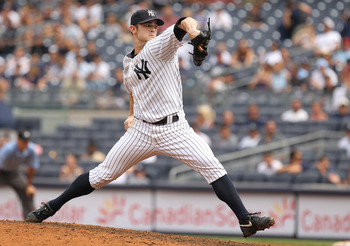 NEW YORK, NY - JULY 24:  David Robertson #30 of the New York Yankees pitches against the Oakland Athletics during their game on July 24, 2011 at Yankee Stadium in the Bronx borough of New York City.  (Photo by Al Bello/Getty Images)