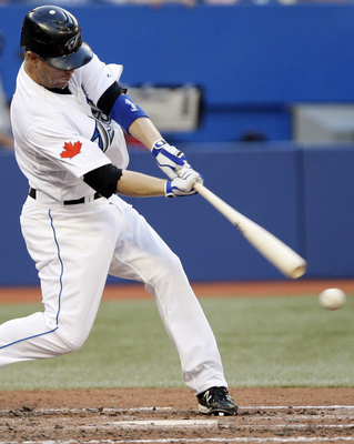 TORONTO, CANADA - JULY 15: Aaron Hill #2 of the Toronto Blue Jays hits against the New York Yankees during MLB action at The Rogers Centre July 15, 2011 in Toronto, Ontario, Canada. (Photo by Abelimages/Getty Images)