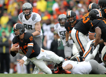 CORVALLIS, OR - DECEMBER 04:  Quarterback Ryan Katz #12 of the Oregon State Beavers is sacked by Casey Matthews #55 of  the Oregon Ducks during the 114th Civil War on December 4, 2010 at the Reser Stadium in Corvallis, Oregon.  (Photo by Jonathan Ferrey/G