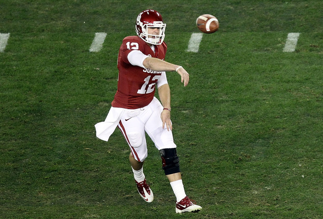 GLENDALE, AZ - JANUARY 01:  Landry Jones #12 of the Oklahoma Sooners throws the ball against the Connecticut Huskies during the Tostitos Fiesta Bowl at the Universtity of Phoenix Stadium on January 1, 2011 in Glendale, Arizona.  (Photo by Christian Peters