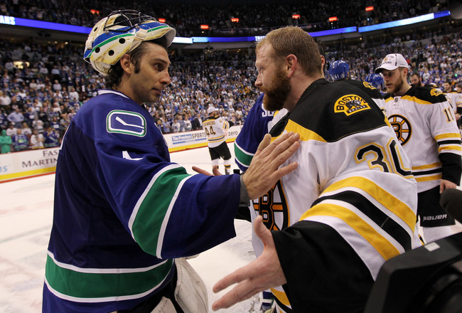 VANCOUVER, BC - JUNE 15:  Roberto Luongo (L) #1 of the Vancouver Canucks congratulates Tim Thomas #30 of the Boston Bruins after defeating the Vancouver Canucks in Game Seven of the 2011 NHL Stanley Cup Final at Rogers Arena on June 15, 2011 in Vancouver,