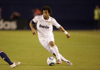 SAN DIEGO, CA - July 20:  Marcelo #12 of Real Madrid dribbles the ball against Xavier Baez #18 of CD Guadalajara during the first half of their game at Qualcomm Stadium on July 20, 2011 in San Diego, California. (Photo by Kent Horner/Getty Images)