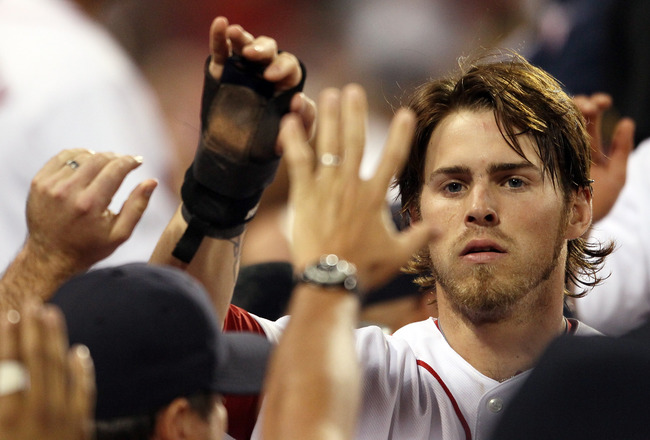 BOSTON, MA - JULY 26:  Josh Reddick #16 of the Boston Red Sox is congratulated after he scored in the fifth inning against the Kansas City Royals on July 26, 2011 at Fenway Park in Boston, Massachusetts.  (Photo by Elsa/Getty Images)