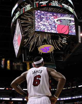 MIAMI, FL - JUNE 12:  LeBron James #6 of the Miami Heat looks on against the Dallas Mavericks in Game Six of the 2011 NBA Finals at American Airlines Arena on June 12, 2011 in Miami, Florida. The Mavericks won 105-95. NOTE TO USER: User expressly acknowle