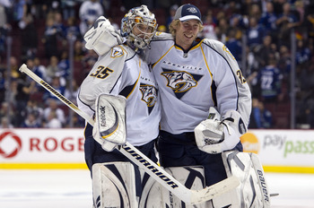 VANCOUVER, CANADA - APRIL 30: Goalie Pekka Rinne #35 of the Nashville Predators is congratulated by backup goalie Anders Lindback #39 after defeating the Nashville Predators 2-1 in the second overtime period in Game Two of the Western Conference Semifinal