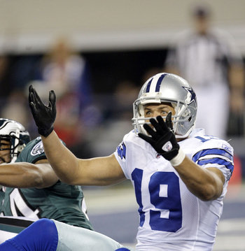 ARLINGTON, TX - JANUARY 9:  Miles Austin #19 of the Dallas Cowboys wants a passing interference penalty called in the endzone on Sheldon Brown #24 of the Philadelphia Eagles in the second quarter during the 2010 NFC wild-card playoff game at Cowboys Stadi