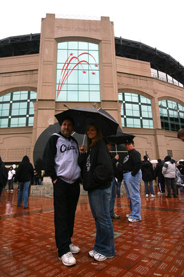 CHICAGO - OCTOBER 05:  Rain falls as fans of the Chicago White Sox arrive at the stadium for Game Three of the ALDS against the Tampa Bay Rays during the 2008 MLB Playoffs at U.S. Cellular Field on October 5, 2008 in Chicago, Illinois.  (Photo by Jamie Sq