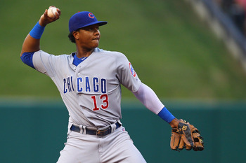ST. LOUIS, MO - JULY 31: Starlin Castro #13 of the Chicago Cubs throws to first base against the St. Louis Cardinals at Busch Stadium on July 31, 2011 in St. Louis, Missouri.  (Photo by Dilip Vishwanat/Getty Images)