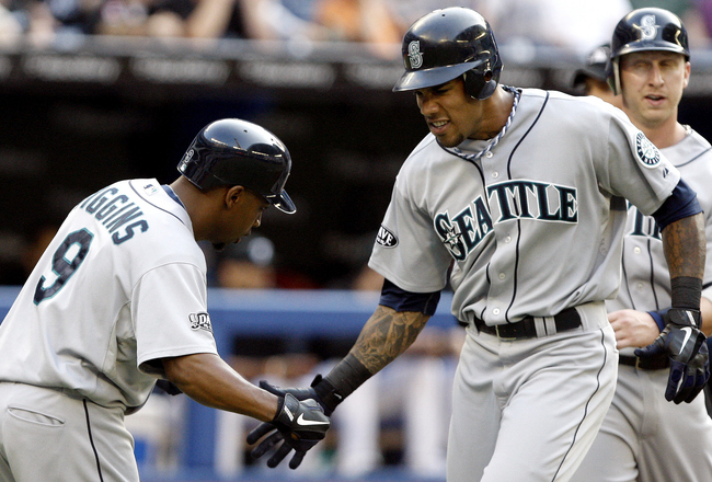 TORONTO, CANADA - JULY 19: Chone Figgins #9 of the Seattle Mariners congratulates teammate Greg Halman #56 after a three-run home run against the Toronto Blue Jays during MLB action at The Rogers Centre July 19, 2011 in Toronto, Ontario, Canada. (Photo by
