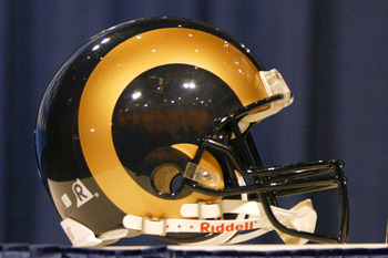 1 Feb 2002:   Helmets for the St. Louis Rams and the New England Patriots sit on either side of the Vince Lombardi Trophy at the Ernest N. Morial Convention Center in New Orleans, Louisiana.  The two teams will play for the trophy in the Super Bowl on Sun