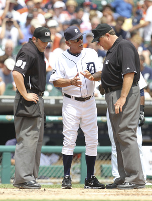 DETROIT - JULY 28: Detroit Tigers manager Jim Leyland #10 argues with home plate umpire Brian Knight #93 and first base umpire Jerry Layne #24 after a disputed call involving Austin Jackson #14 getting hit in the hand during the third inning of the game a