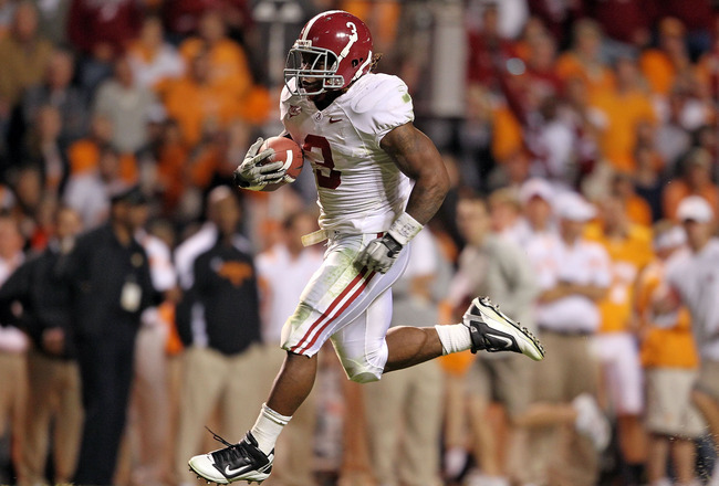 KNOXVILLE, TN - OCTOBER 23:  Trent Richardson #3 of the Alabama Crimson Tide runs for a touchdown during the SEC game against the Tennessee Volunteers at Neyland Stadium on October 23, 2010 in Knoxville, Tennessee.  (Photo by Andy Lyons/Getty Images)