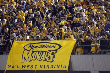 MORGANTOWN, WV - DECEMBER 1: Fans of the West Virginia Mountaineers watch the game during the game against the Pittsburgh Panthers at Milan Puskar Stadium on December 1, 2007 in Morgantown, West Virginia. (Photo by Kevin C. Cox/Getty Images)
