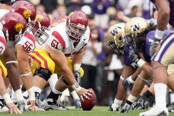 SEATTLE - SEPTEMBER 19: Center Kristofer O'Dowd #61of the USC Trojans gets ready to hike the ball during the game against the Washington Huskies on September 19, 2009 at Husky Stadium in Seattle, Washington. The Huskies defeated the Trojans 16-13. (Photo