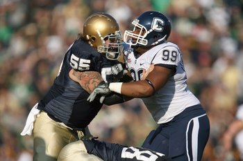SOUTH BEND, IN - NOVEMBER 21: Guard Eric Olsen #55  of the Notre Dame Fighting Irish blocks Kendall Reyes #99 of the Univeristy of Connecticut Huskies at Notre Dame Stadium on November 21, 2009 in South Bend, Indiana. (Photo by Jonathan Daniel/Getty Image