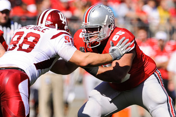 COLUMBUS, OH - OCTOBER 9:  Justin Boren #65 of the Ohio State Buckeyes blocks against the Indiana Hoosiers at Ohio Stadium on October 9, 2010 in Columbus, Ohio.  (Photo by Jamie Sabau/Getty Images)