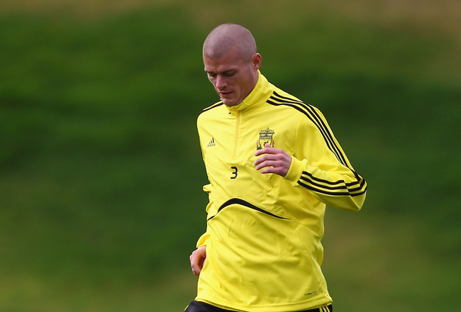 LIVERPOOL, ENGLAND - NOVEMBER 03: Paul Konchesky of Liverpool in action during a training session ahead of their UEFA Europa League match against SSC Napoli at Melwood Training Ground  on November 3, 2010 in Liverpool, England.  (Photo by Clive Brunskill/
