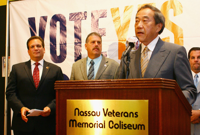 UNIONDALE, NY - AUGUST 01: Owner Charles Wang (R) of the New York Islanders addresses the media to announce that the new arena voter referendum failed as Nassau County Executive Ed Mangano (L) and a member of the labor union look on at the Nassau Coliseum