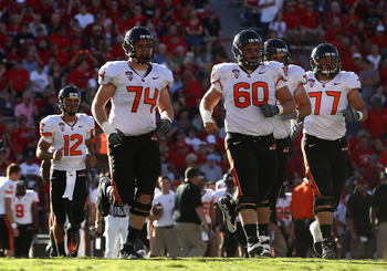TUCSON, AZ - OCTOBER 09:  (L-R) Ryan Katz #12, Burke Ellis #74, Alex Linnenkohl #60 and Michael Philipp #77 of the Oregon State Beavers during the college football game against the Arizona Wildcats at Arizona Stadium on October 9, 2010 in Tucson, Arizona.