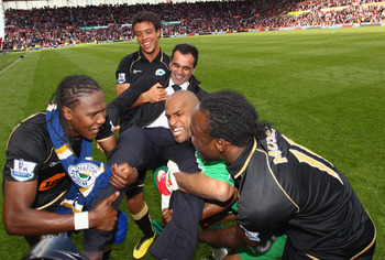 STOKE ON TRENT, ENGLAND - MAY 22:  Manager Roberto Martinez of Wigan celebrates victory with his team after the Barclays Premier League match between Stoke City and Wigan Athletic at Britannia Stadium on May 22, 2011 in Stoke on Trent, England.  (Photo by