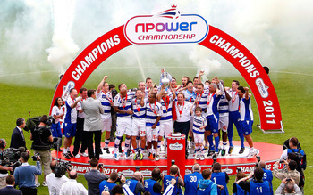 LONDON, ENGLAND - MAY 07:  QPR players celebrate with the trophy after the npower Championship match between Queens Park Rangers and Leeds United at Loftus Road on May 7, 2011 in London, England.  (Photo by Dan Istitene/Getty Images)