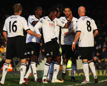LONDON, ENGLAND - JANUARY 22:  Goalscorer Clint Dempsey (2ndR) of Fulham celebrates his goal with team mates during the Barclays Premier League match between Fulham and Stoke City at Craven Cottage on January 22, 2011 in London, England.  (Photo by Clive