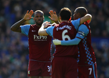 LIVERPOOL, ENGLAND - APRIL 02:  Darren Bent of Aston Villa celebrates with Stewart Downing and Ashley Young after scoring his first goal during the Barclays Premier League match between Everton and Aston Villa at Goodison Park on April 2, 2011 in Liverpoo