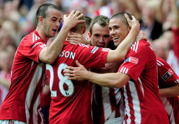 LONDON, ENGLAND - APRIL 17:  Stoke City celebrates the fifth goal scored by Jonathan Walters (R) during the FA Cup sponsored by E.ON semi final match between Bolton Wanderers and Stoke City at Wembley Stadium on April 17, 2011 in London, England.  (Photo