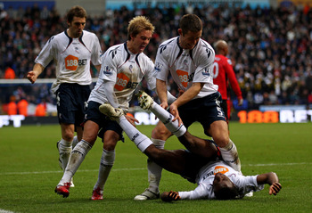 BOLTON, ENGLAND - DECEMBER 12:  Fabrice Muamba of Bolton Wanderers celebrates scoring the opening goal with team mates Stuart Holden and Gary Cahill (R) during the Barclays Premier League match between Bolton Wanderers and Blackburn Rovers at the Reebok S