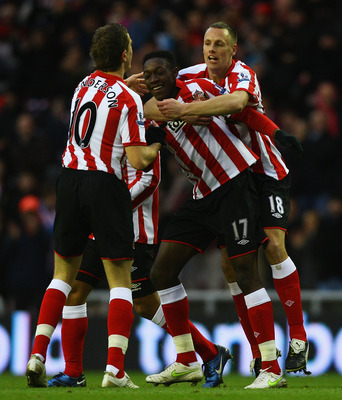 SUNDERLAND, ENGLAND - JANUARY 01:  Danny Welbeck of Sunderland is congratulated by his team mates, after scoring a goal during the Barclays Premier League match between Sunderland and Blackburn Rovers at the Stadium of Light on January 1, 2011 in Sunderla