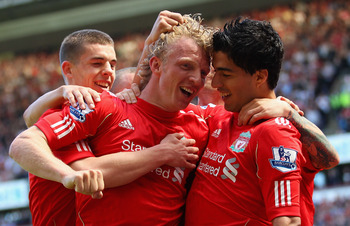 LIVERPOOL, ENGLAND - MAY 01:  Luis Suarez of Liverpool celebrates with team mate Dirk Kuyt after scoring the third goal during the Barclays Premier League match between Liverpool  and Newcastle United at Anfield on May 1, 2011 in Liverpool, England.  (Pho