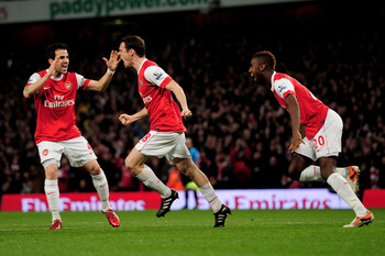 LONDON, ENGLAND - FEBRUARY 23:  Sebastien Squillaci (C) of Arsenal celebrates with teammates Cesc Fabregas (L) and Johan Djourou (R) after he scores the opening goal during the Barclays Premier League match between Arsenal and Stoke City at the Emirates S