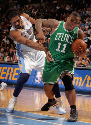 DENVER, CO - FEBRUARY 24:  Nene #31 of the Denver Nuggets contests Glen Davis #11 of the Boston Celtics for control of the ball during NBA action at the Pepsi Center on February 24, 2011 in Denver, Colorado. The Nuggets defeated the Celtics 89-75. NOTE TO