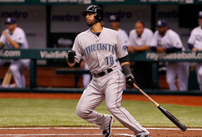 ST. PETERSBURG, FL - AUGUST 03:  Infielder Jose Bautista #19 of the Toronto Blue Jays fouls off a pitch against the Tampa Bay Rays during the game at Tropicana Field on August 3, 2011 in St. Petersburg, Florida.  (Photo by J. Meric/Getty Images)