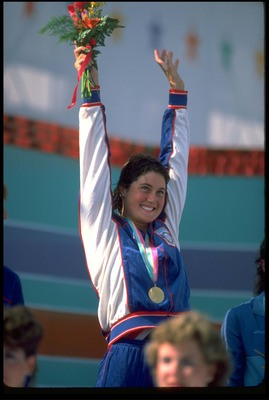 2 AUG 1984:  MARY T. MEAGHER OF THE UNITED STATES CELEBRATES AFTER RECEIVING THE GOLD MEDAL FOR HER VICTORY IN THE 100 METRES BUTTERFLY. MEAGHER WON COMFORTABLY BUT DID NOT COME CLOSE TO MATCHING THE WORLD RECORD TIME SHE HAD SET FOUR YEARS PREVIOUSLY.